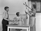 1940s Housewife in Kitchen Showing Plucked Turkey to Children Photographic Print