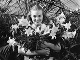 Young Woman with Arms Full of Easter Lillies Photographic Print by Philip Gendreau