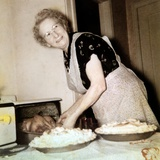 Grandma Cooks in the Kitchen, Ca. 1952 Photographic Print