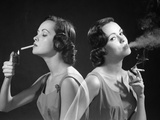 1960s Multiple Exposure Two Views Brunette Woman Smoking a Cigarette Lighting it and Exhaling Smoke Photographic Print