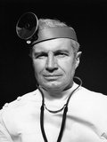 1940s Portrait of Senior Doctor Wearing Ophthalmoscope Photographic Print