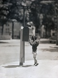 Child Reaching into Mailbox Photographic Print by Philip Gendreau