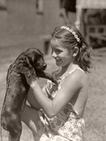 Girl Holding Puppy Photographic Print by Philip Gendreau