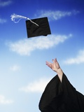 Graduate Tossing Mortarboard Hat into the Air Photographic Print