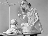 1940s Girl Shaking Her Finger at Doll over Toy Laundry Basket Photographic Print