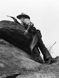 1920s Cowboy Among Rocks Aiming Revolver Photographic Print