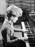 Boy Practicing Piano Photographic Print by Philip Gendreau