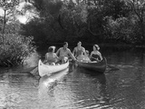 1930s Summertime Group of Five Young Men and Women in Two Canoes Paddling Down a Stream Fotografiskt tryck
