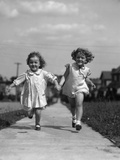 1930s Two Children Running Skipping on Sidewalk Smiling Photographic Print