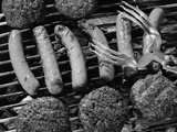 1950s Grill Filled with Hot Dogs and Hamburgers and Tongs Reaching Down to Turn Them Over Photographic Print by L. Fritz