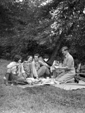 1920s Four People Two Couples Men Women Sitting on Ground Enjoying a Picnic Photographic Print