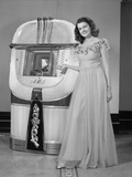 1940s Smiling Woman with a Jukebox Photographic Print
