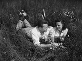 Young Couple Lying in the Grass Photographic Print by Philip Gendreau
