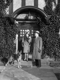 1920s Couple Wearing Coat Hat Gloves on Steps Ivy Covered Building with German Shepherd Dog Photographic Print