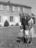 1960s Family Portrait in Front of Suburban Home Photographic Print