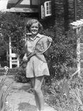 1930s Teen Girl Brunette on Sidewalk of House Holding Tennis Racket Wearing Shorts Photographic Print