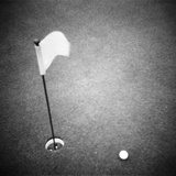 2000S Golf Ball on Putting Green with Flag Marker in Hole from Above Photographic Print by K. Tichenor