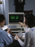 1980s Couple Working at Apple III 3 Home Computer Paying Bills Photographie par K. Vreeland