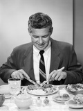 1950s Smiling Man in Suit and Tie Sitting at Table Holding Knife and Fork Eating Dinner Photographic Print