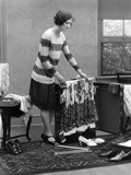 1920s Woman Packing Clothes for Travel Photographic Print