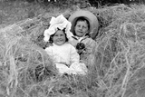 A Young Brother and Sister Nestled in the Hay, Ca. 1900 Photographic Print