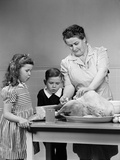1940s Mother Son Daughter in Kitchen Stuffing Turkey for Thanksgiving Dinner Photographic Print