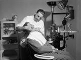 Dentist Working on Patient Photographic Print by Philip Gendreau