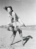 Girls Playing Leapfrog on Beach Photographic Print by Philip Gendreau
