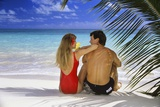 Couple on Tropical Beach with Palm Frond Ocean and Sky Photographic Print