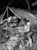 1920s Two Men at Primitive Campsite One Man in a Frame Tent Lighting Cigarette Photographic Print