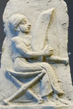 Terracotta Relief of Harpist Photographic Print