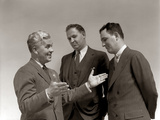 1940s One Man Telling Story to Two Other Men Using Hand Gestures Photographic Print
