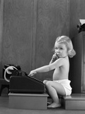 1940s Child Sitting Typing on Adding Machine Funny Facial Expression Photographic Print