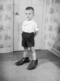 Boy Wearing Men's Shoes Fotografisk trykk av Philip Gendreau