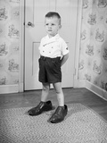 Boy Wearing Men's Shoes Photographic Print by Philip Gendreau