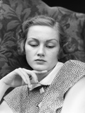 1930s Portrait of Woman Looking Down with Sad Expression and Her Chin Resting on Index Finger Photographic Print