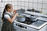Girl Stirring Soup in Kitchen Photographic Print by William P. Gottlieb