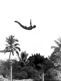 1940s Man Poised Midair Arms Out Jumping from Diving Board into Pool Stampa fotografica