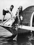 1920s Man and Woman in Bathing Suits Crabbing Off Old Abandoned Wooden Boat Photographic Print