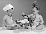 1960s Two Babies Playing Doctor and Nurse with Doll Studio Stampa fotografica