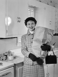 1950s Smiling Woman in Kitchen Holding Grocery Bag Handbag Wearing Hat Gloves Photographic Print