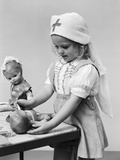 1940s Child Playing Nurse with Dolls Photographic Print
