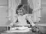 1950s Smiling Girl Rolling Dough in Flour Baking in Kitchen Photographic Print