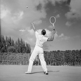 1930s Back View of Man Playing Tennis About to Hit the Ball Summer Outdoor Photographic Print