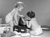 1960s Pair of Babies around Adding Machine with Telephone Off Hook and Papers Scattered on Floor Photographic Print