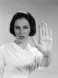 1960s Woman Holding Up Hand Palm Forward Commanding Stop Photographic Print