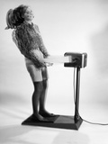 1960s Woman Massaged by Vibrating Exercise Machine Photographic Print