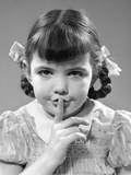 1940s Girl Holding Finger to Lips Making Shushing Gesture Photographic Print
