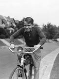 1930s Smiling Boy Riding Bicycle Photographic Print