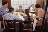 Family Eating Together at Dinner Table Photographic Print by William P. Gottlieb